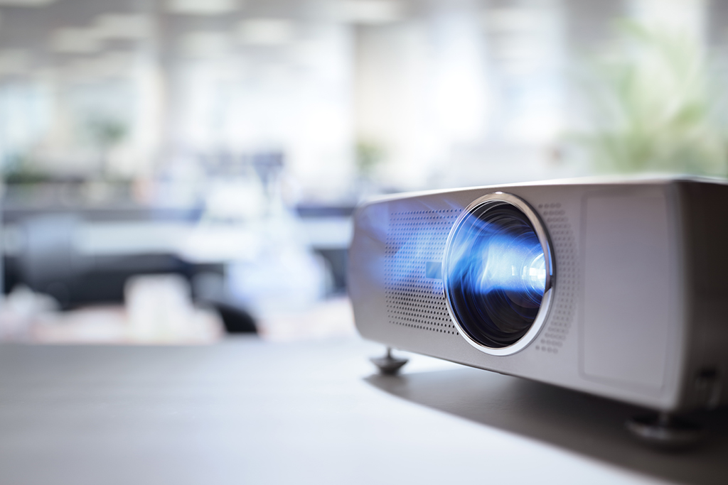 LCD video projector at business conference or lecture in office with copy space